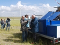 Aart de Wachter explaining the function of the ground station, film crew in the background