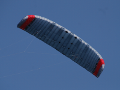 The 21m2 ram-air wing of the EnerKite system during flight with clearly visible air inlets at the leading edge of the wing